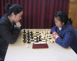 Nicole Tsoi playing runner-up Wan Xin Chen