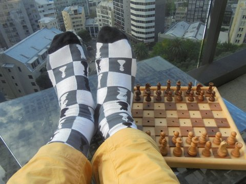 Feet up on chess board